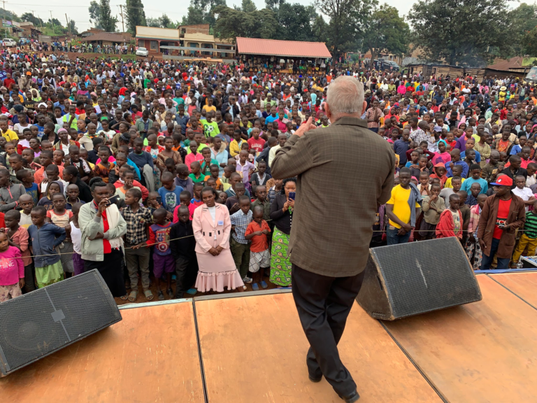 Peter Doseck preaching to a large crowd